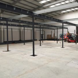 Mezzanine floor steel work being installed